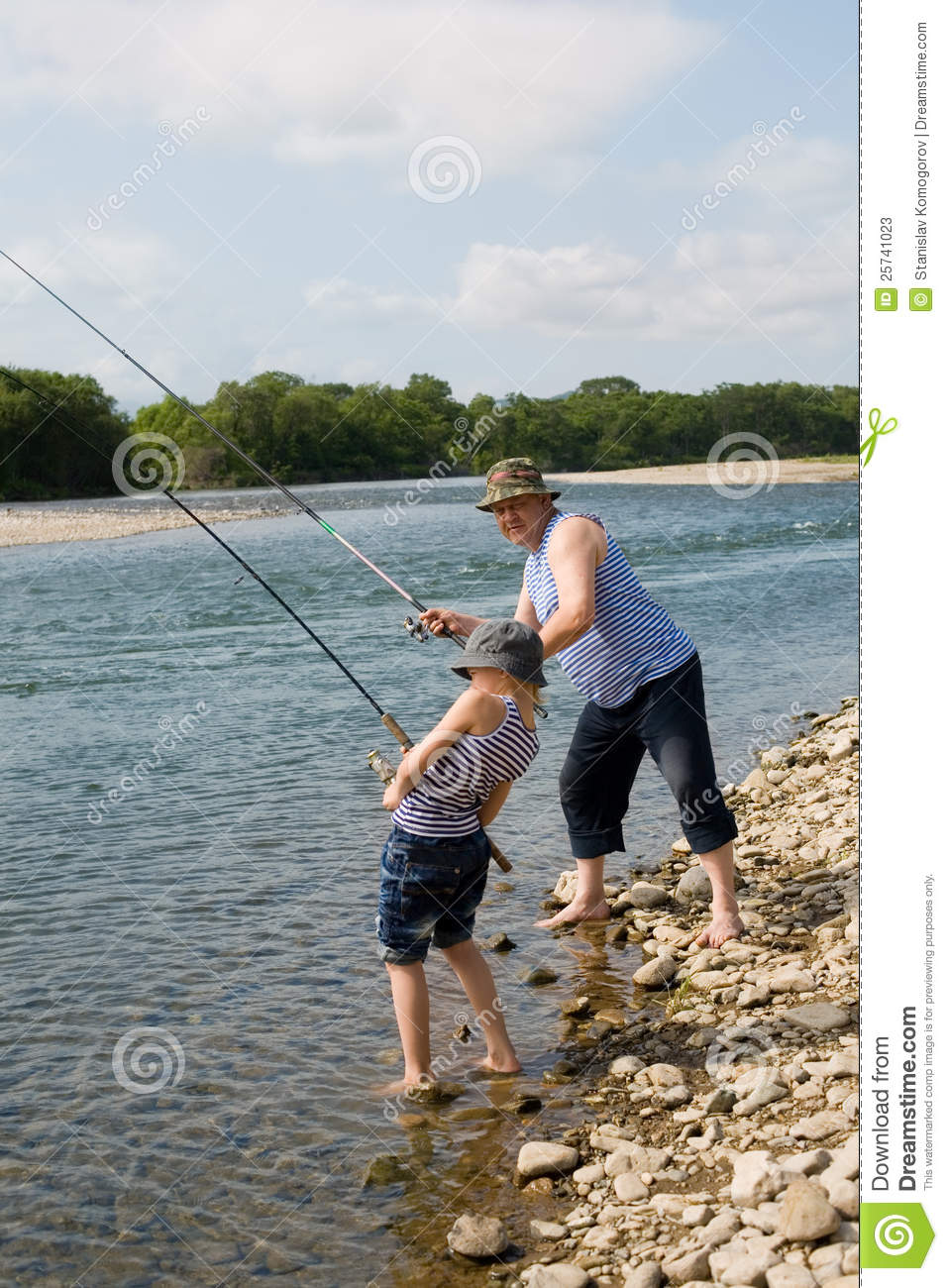 Grandfather and grandson fishing