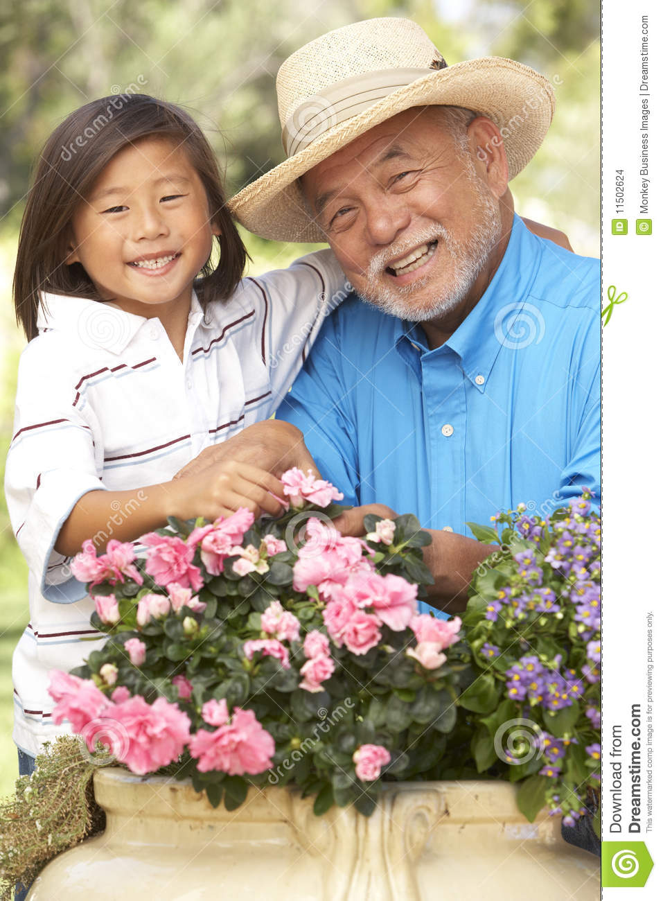 Grandfather And Grandson Gardening Together