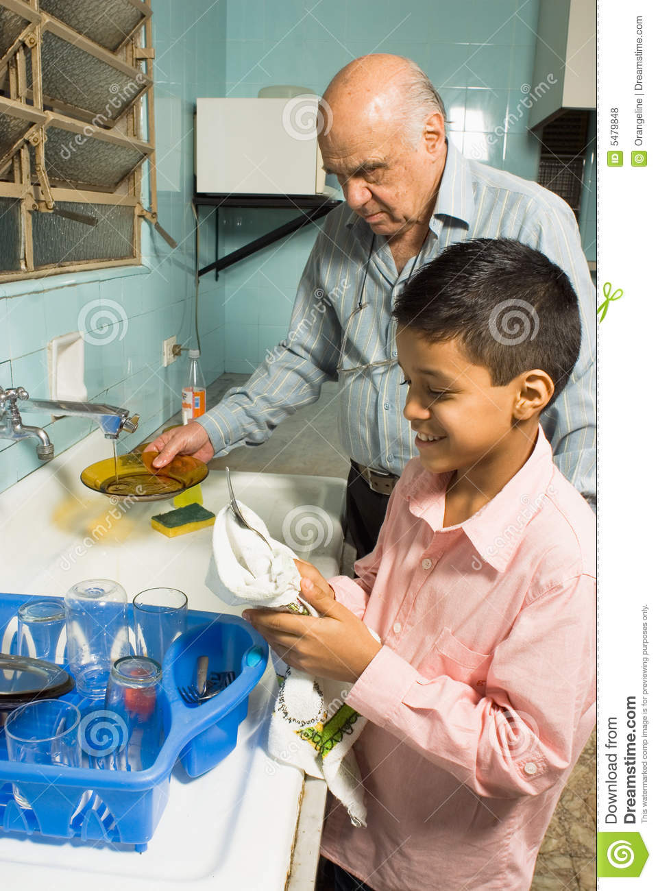 Grandfather and grandson washing dishes - Vertical