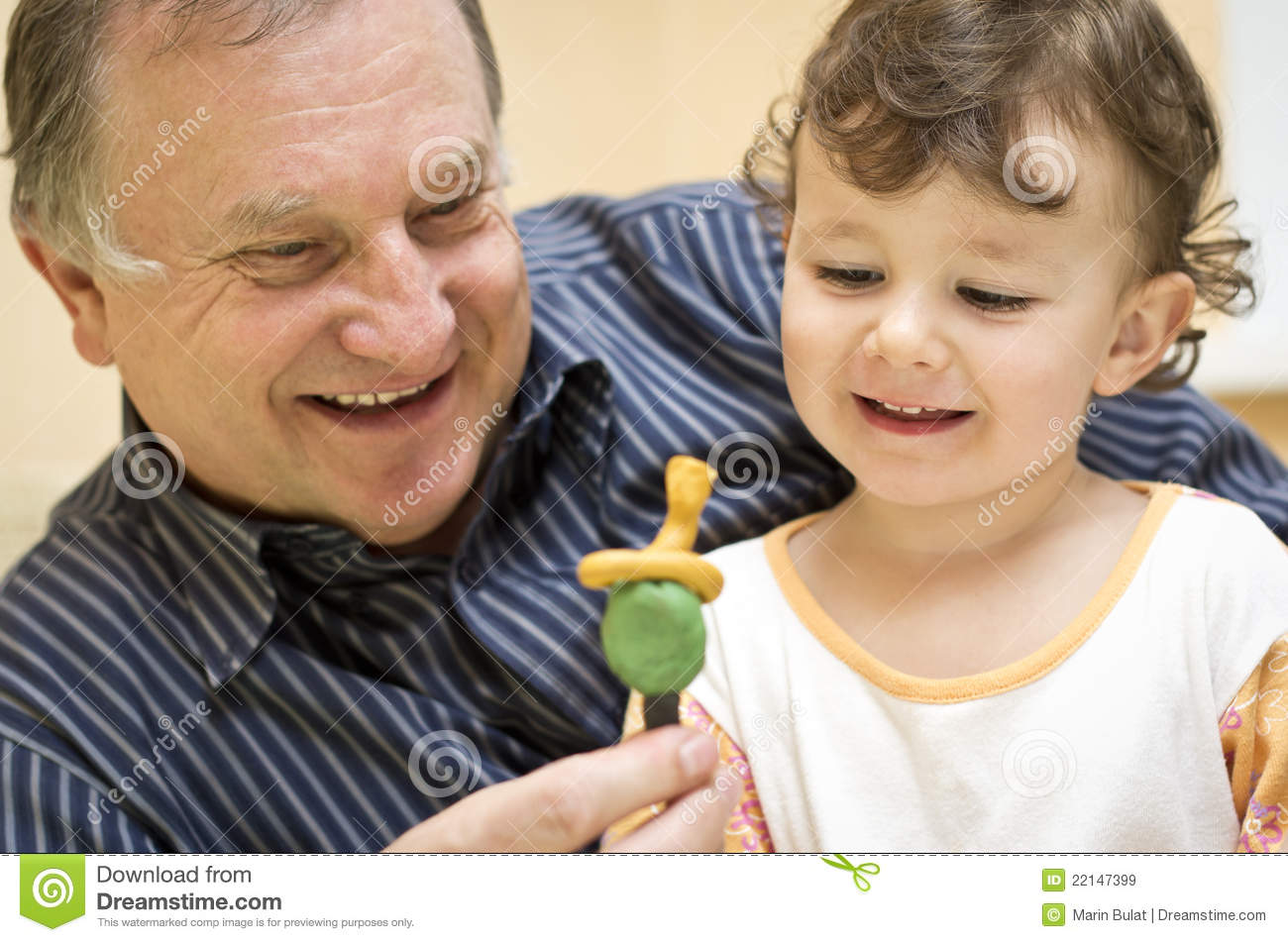 Grandfather playing with granddaughter
