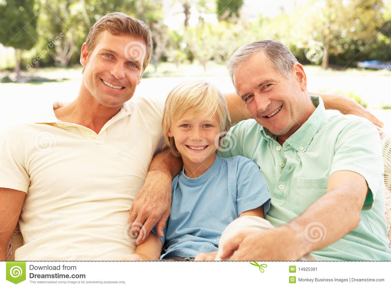 Grandfather Son And Grandson Relaxing On Sofa Stock Image