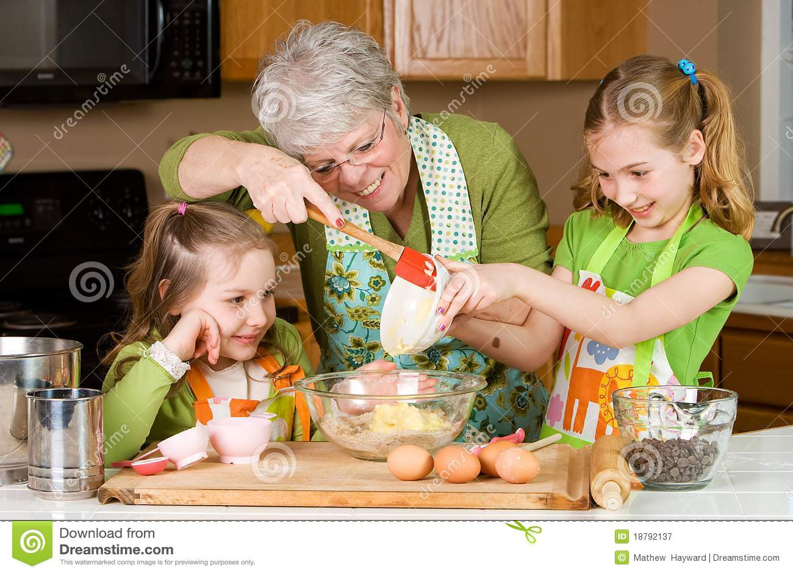 Grandmother baking cookies with children.