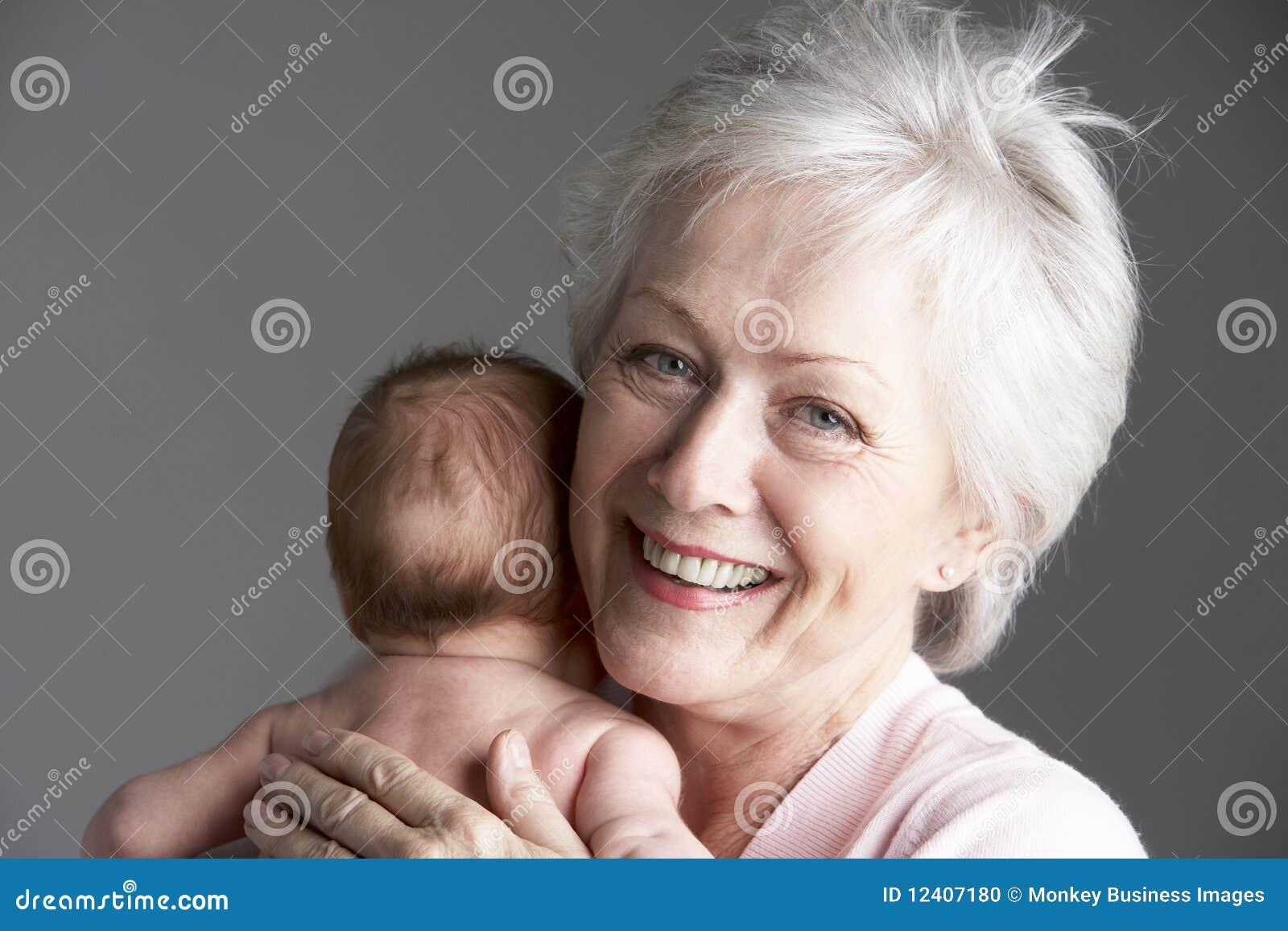 Grandmother Cuddling Granddaughter