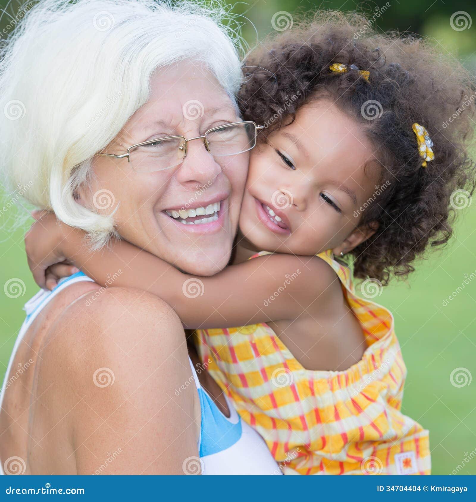 Grandmother hugs her hispanic granddaughter
