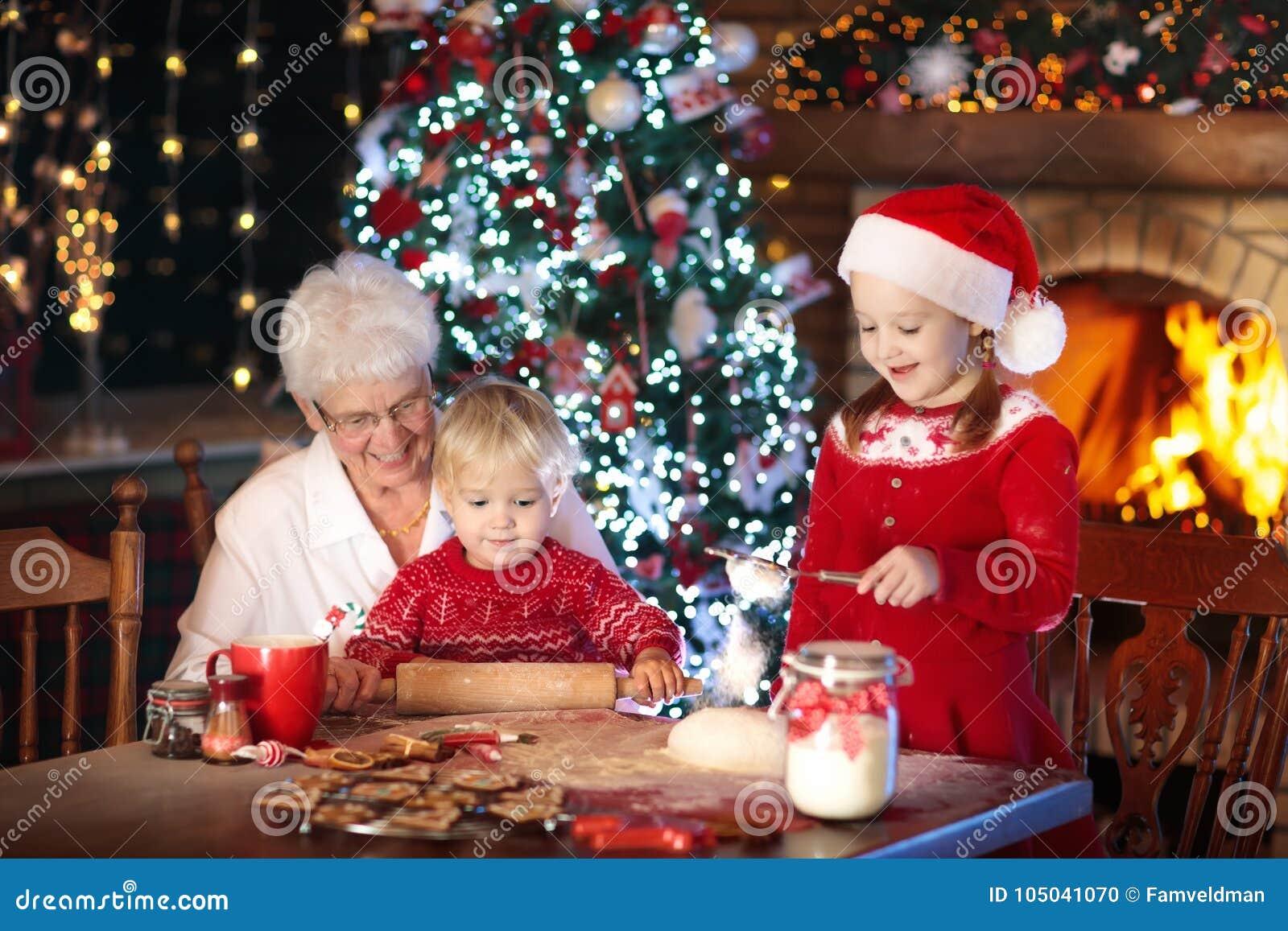 Grandmother And Kids Bake Christmas Cookies Stock Photo