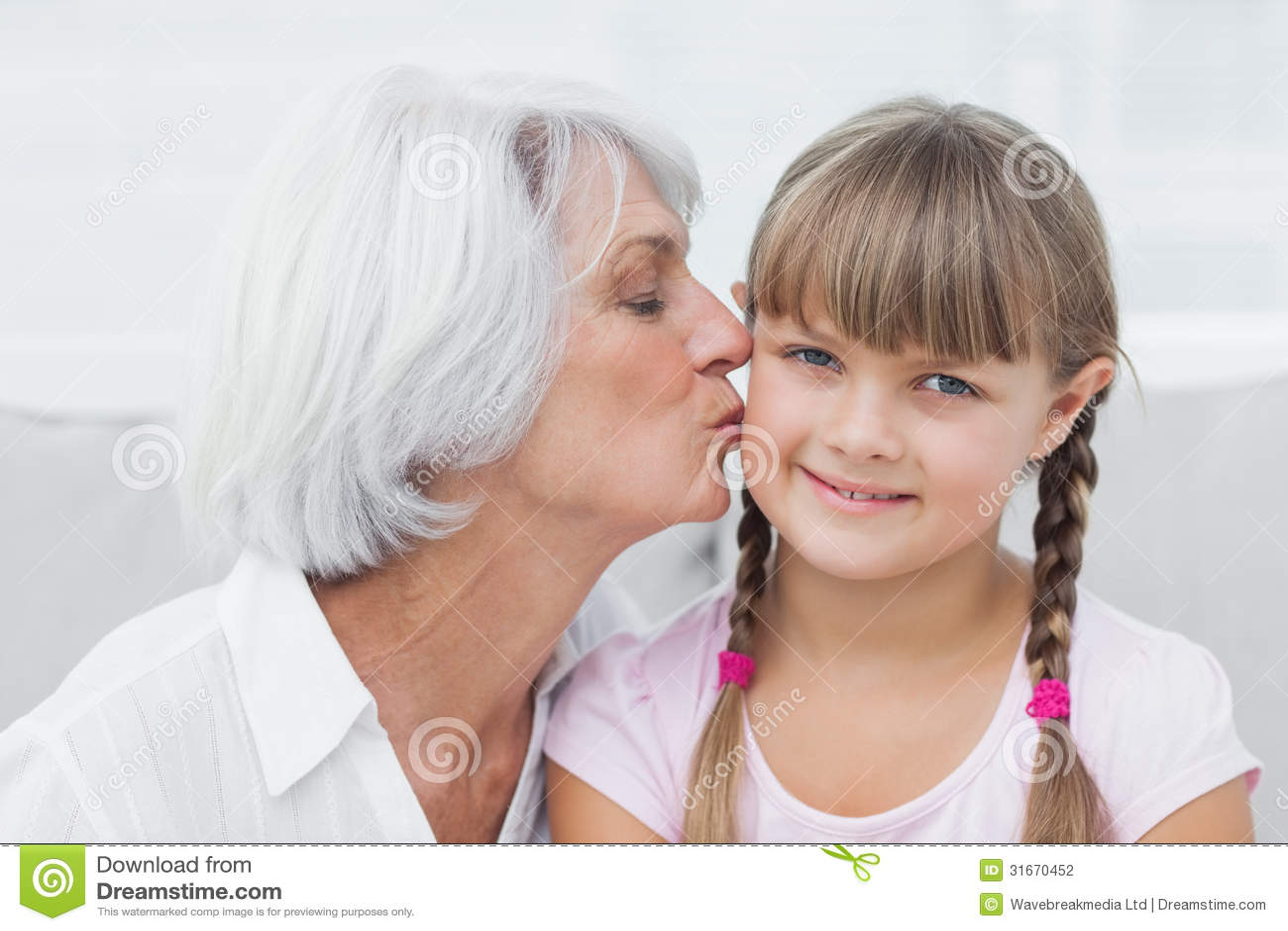 Grandmother Kissing Her Cute Granddaughter Stock