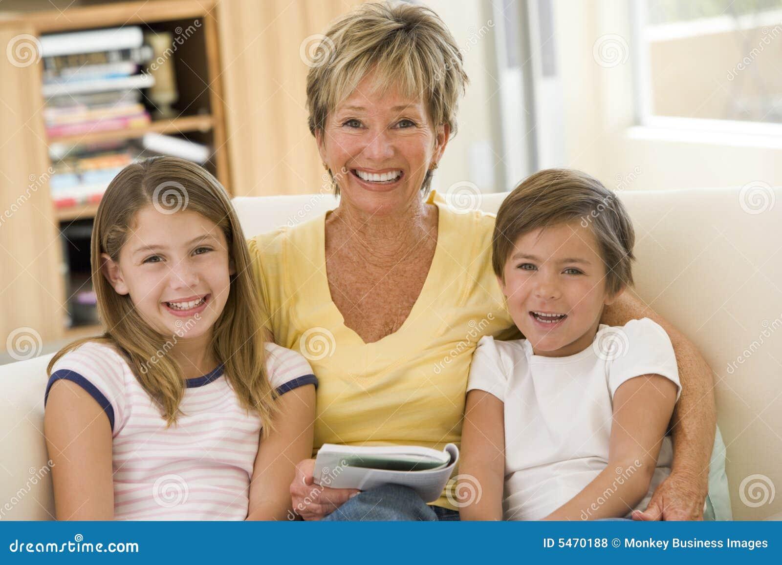 Grandmother reading with grandchildren