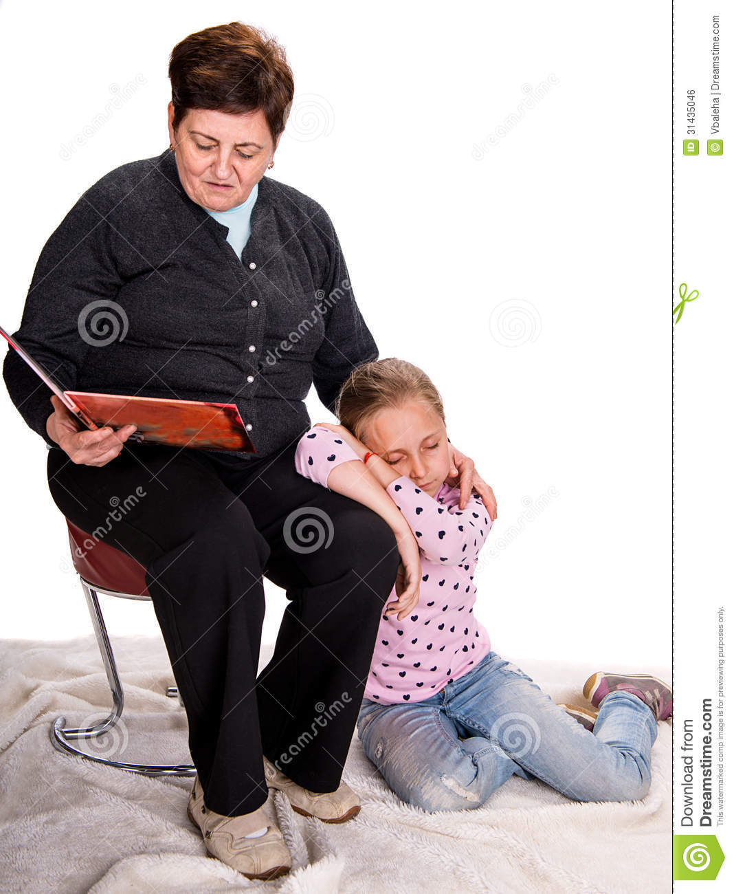 Grandmother reading a novel to her granddaughter on a white background ...
