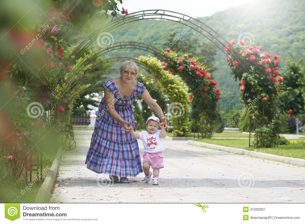 Grandmother teaching little girl to walk