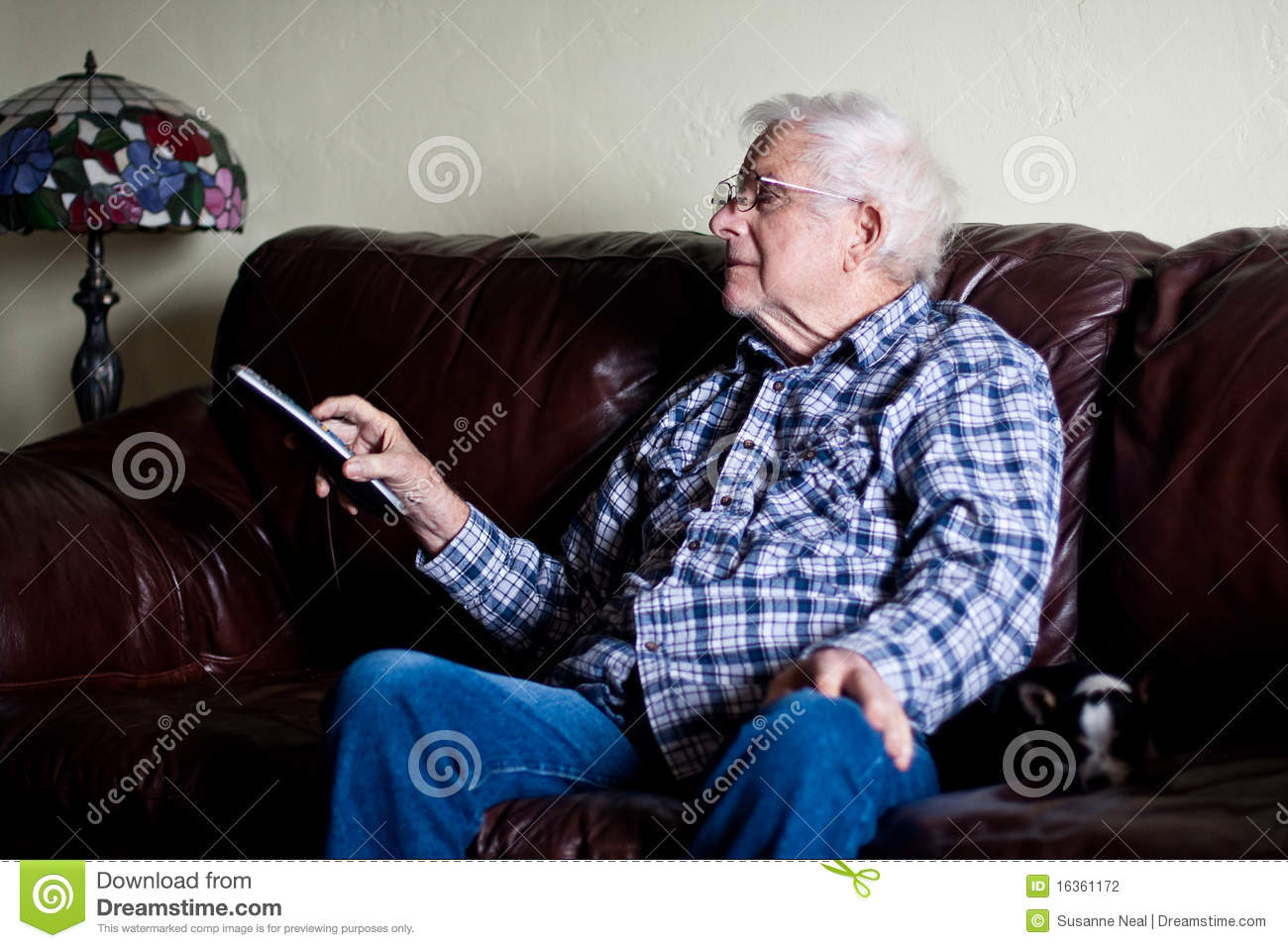 Grandpa Changes Tv Channel With Remote Control Stock Photo