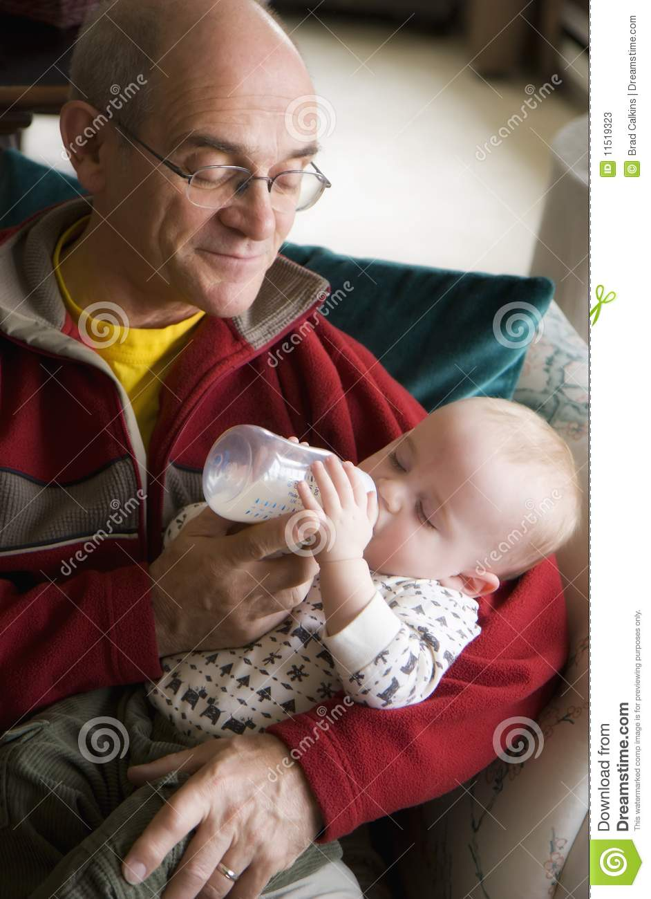 Grandpa Feeding Baby Stock Image Image Of Baby Males