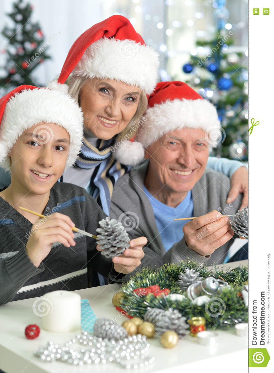 Grandparents with boy preparing for Christmas