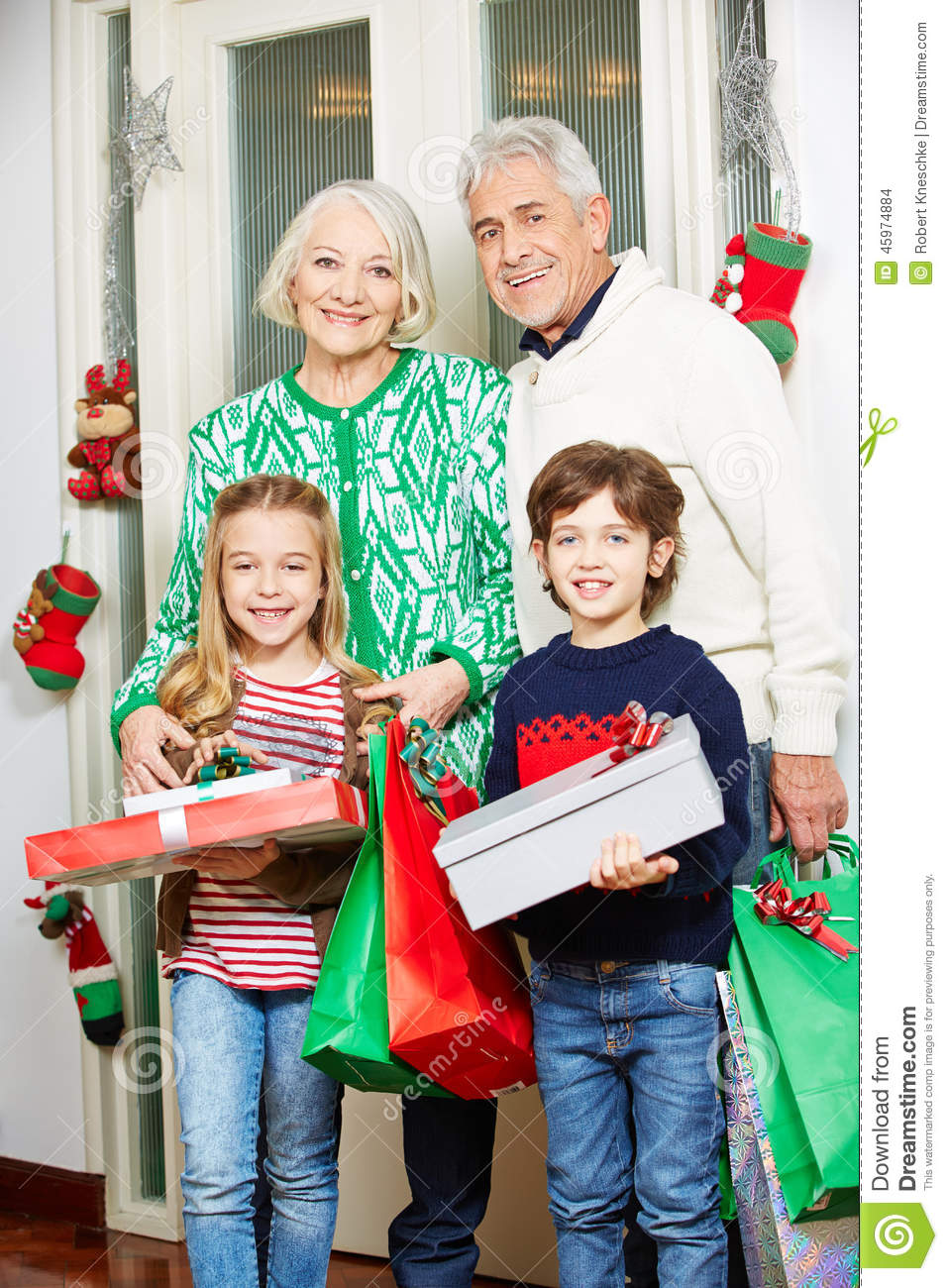 Grandparents With Grandchildren And Gifts At Christmas Stock Photo ...