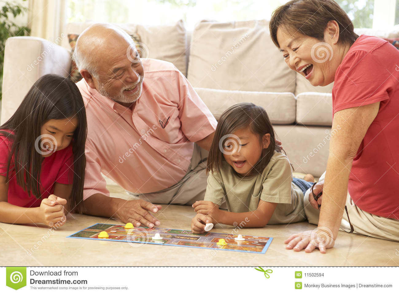 Grandparents And Grandchildren Playing Board Game