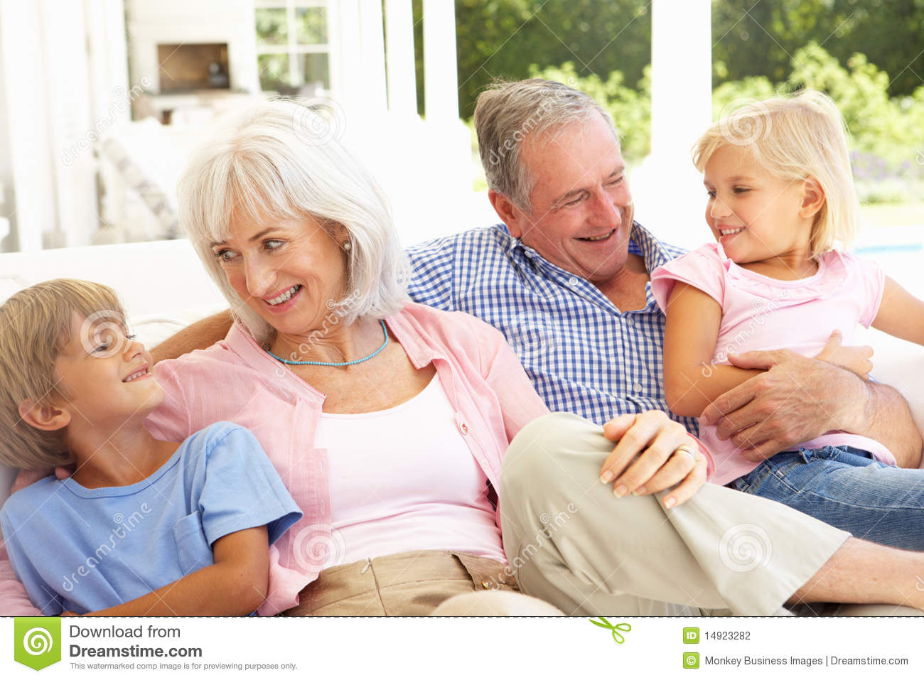 Grandparents With Grandchildren Relaxing Together Stock ...