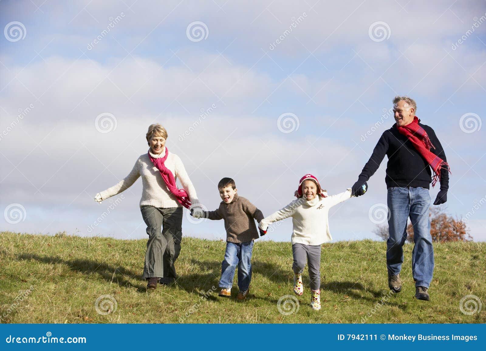 Grandparents And Grandchildren Running