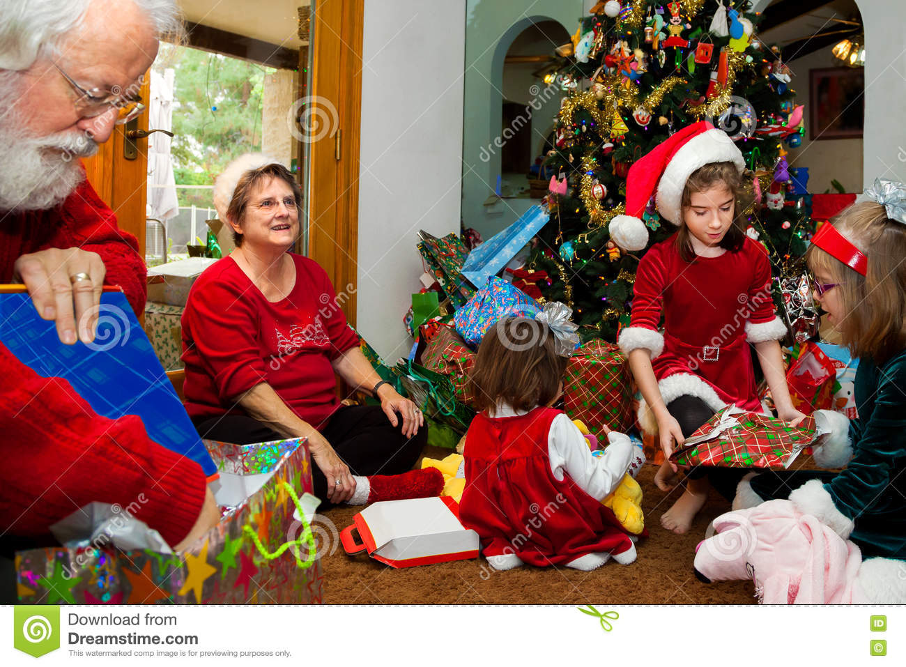 Grandparents And Grandkids Unwrap Christmas Presents Stock Image ...