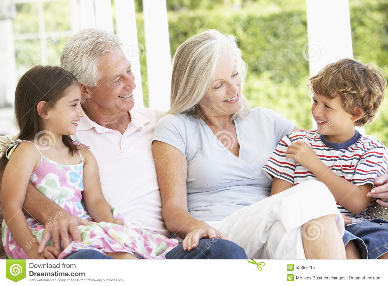 Grandparents Sitting Outisde With Grandchildren Stock ...