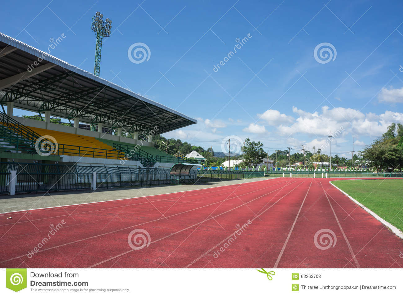 Soccer Football On Green Field With Blue Sky Background: Grandstand, Race Track , Football Field And Blue Sky Stock