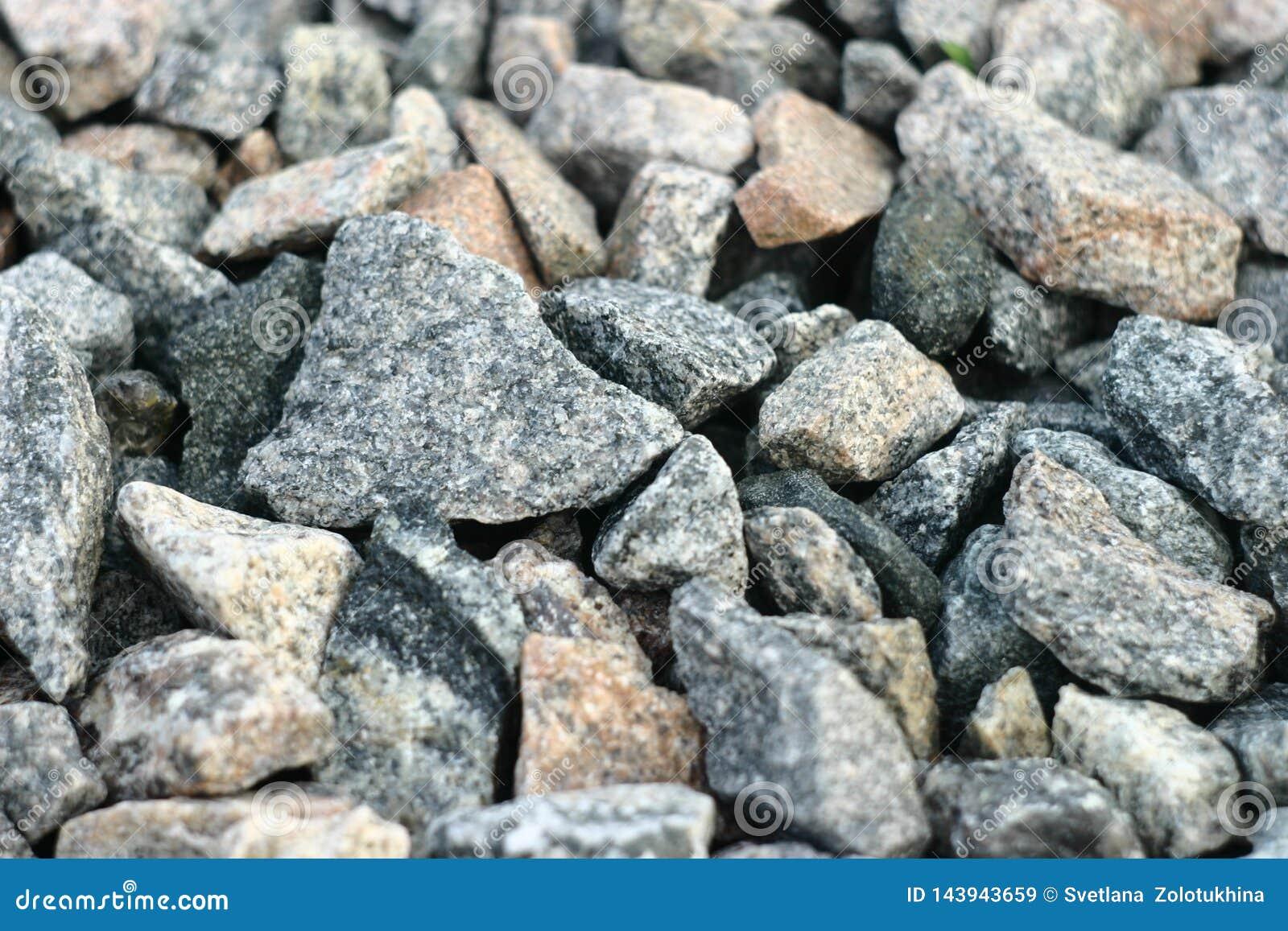 Granit zerquetschter Stein vom Felsen der granulierten Struktur