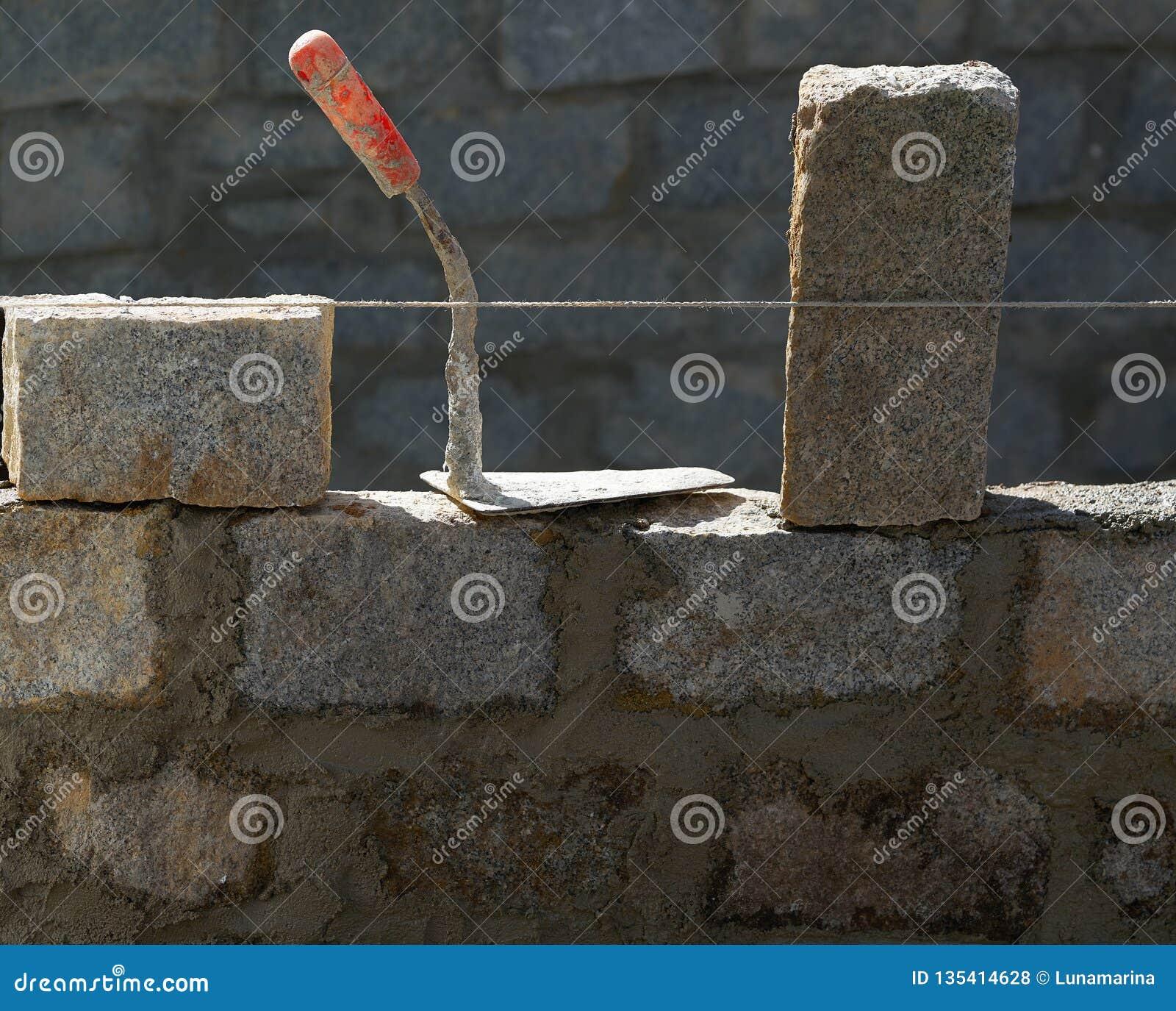 Granite blocks wall construction with mortar