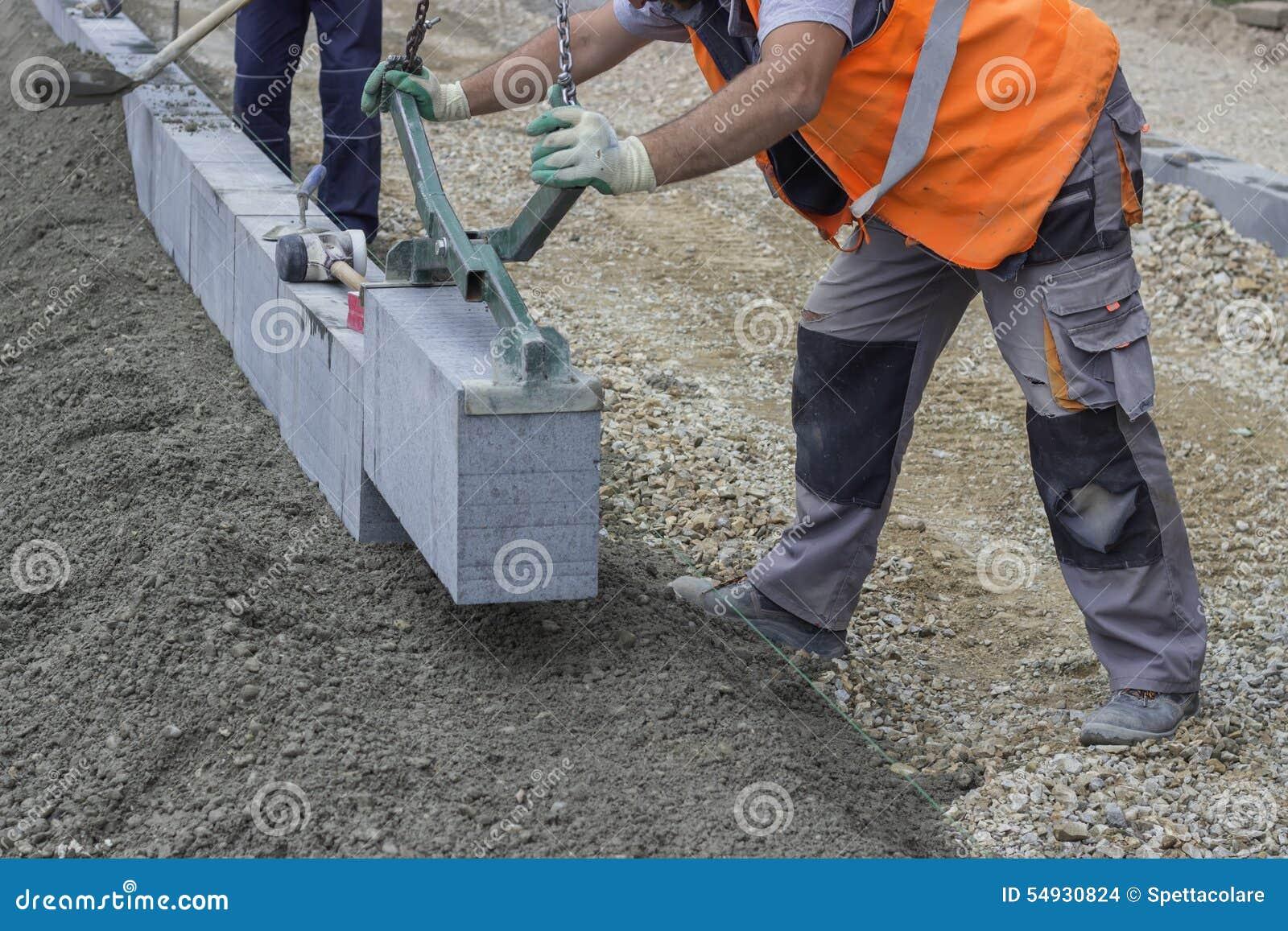 Granite Curb Pricing : Granite curbing installation vertical stock photo