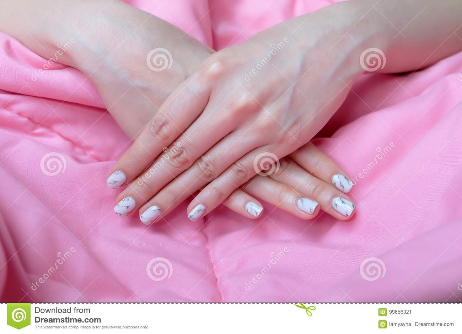 Granite Gray Nail. Close Up Nails Polish, Manicure Granite Gray Nail on Pink Blanket Background