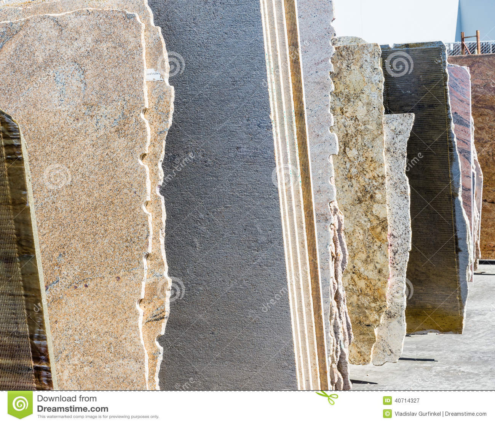 Granite Slab Yards : Colorful granite slabs for sale in store yard.