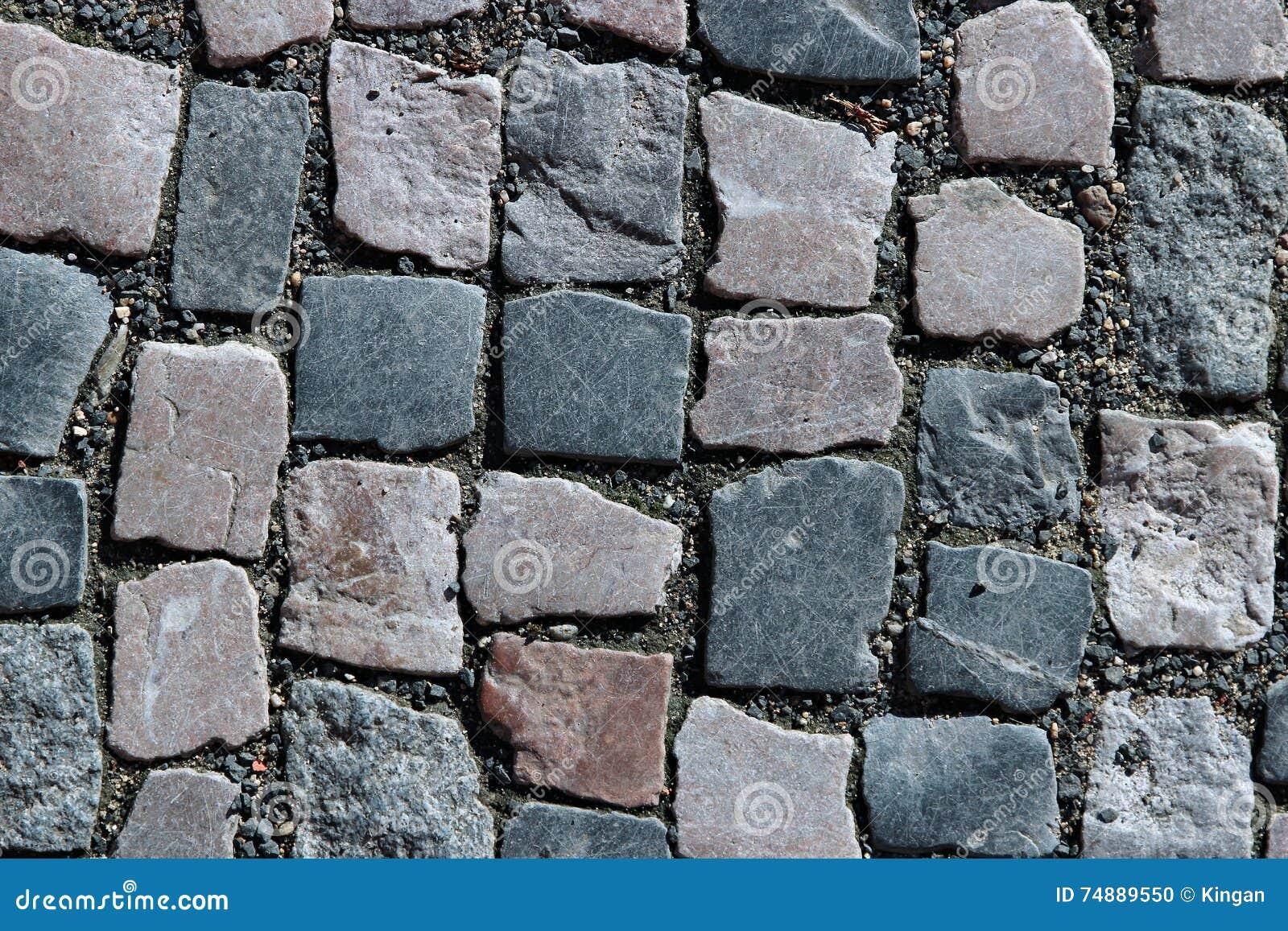 Granito que pavimenta em Praga