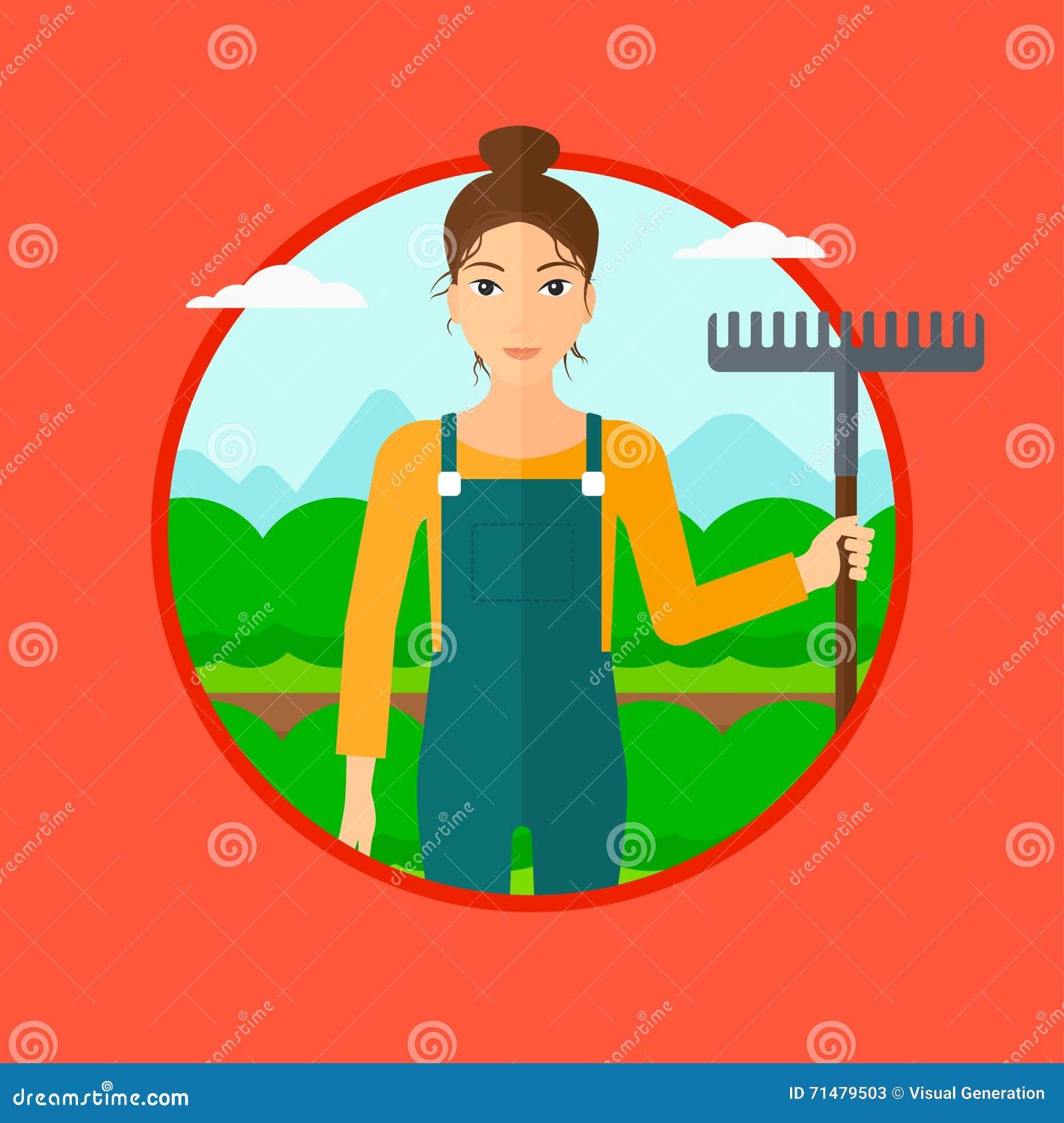Granjero con el rastrillo en el campo de la col