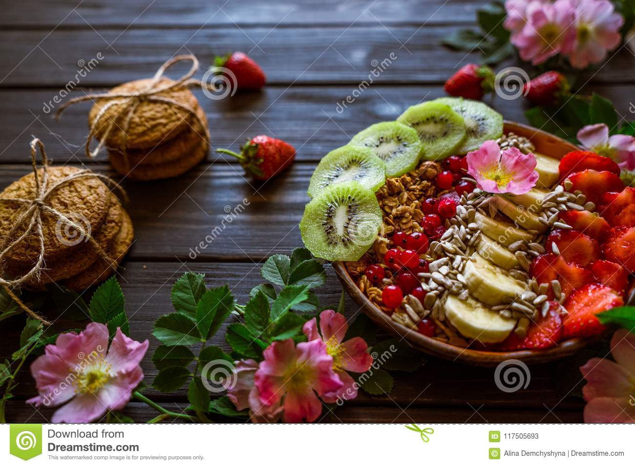 Granola fruit and biscuits stock image image of fresh diet granola with fruits strawberries bananas kiwi sunflower seeds pink flowers with green leaves oatmeal cookies for breakfast on a black wooden mightylinksfo