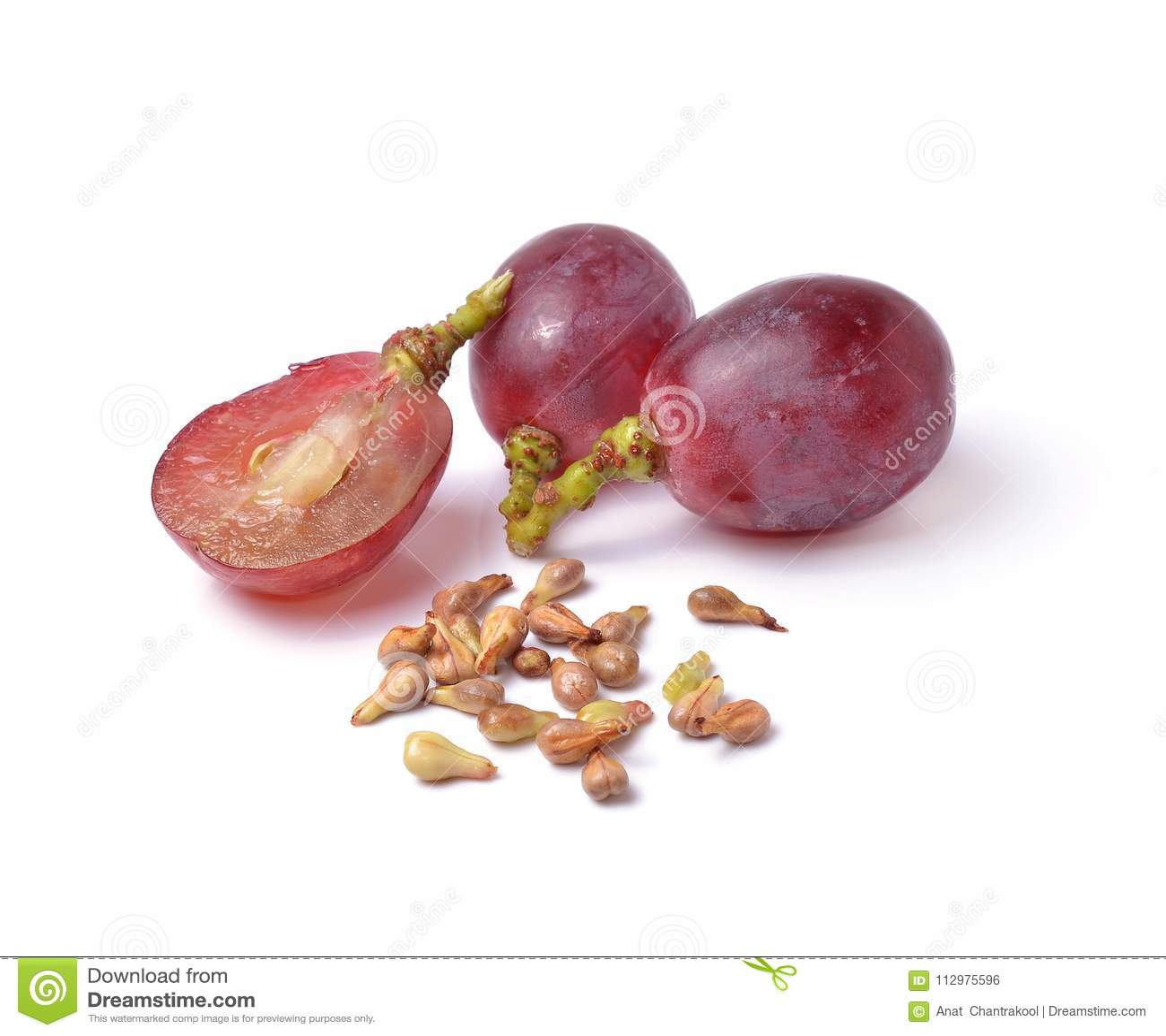 Grape seeds on white background macro closeup