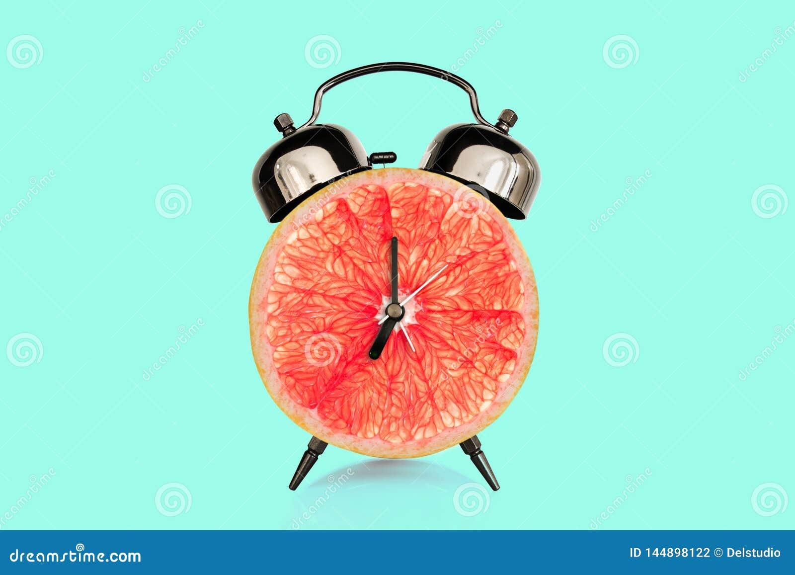 Grapefruit Slice On Alarm Clock, Blue Pastel Background ...