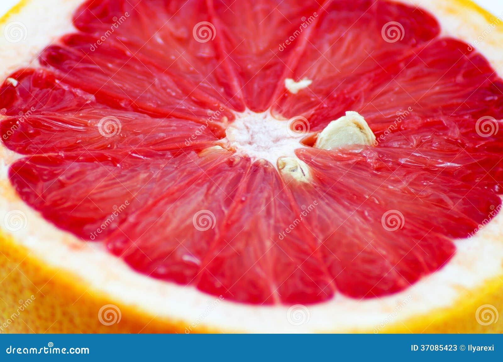 Download Grapefruitowy plasterek obraz stock. Obraz złożonej z desery - 37085423