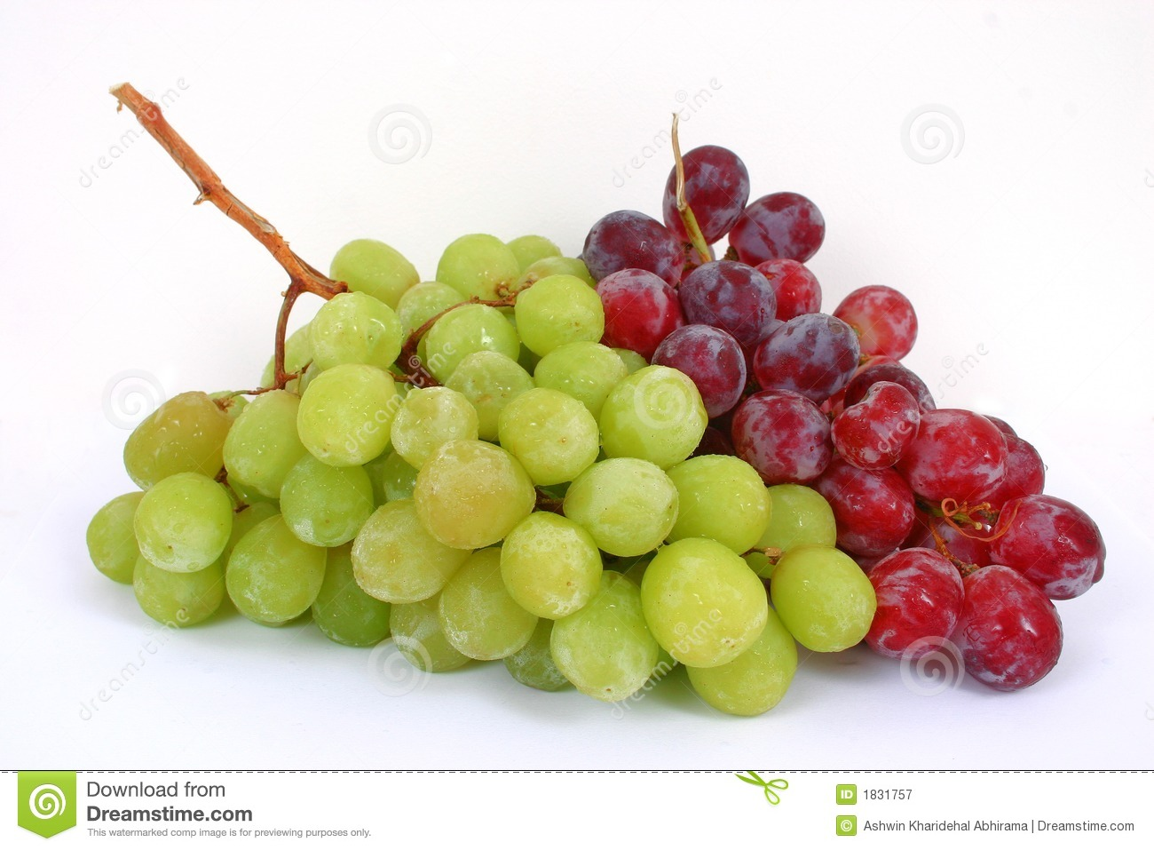 bunch of green and red grapes isolated in a white background.