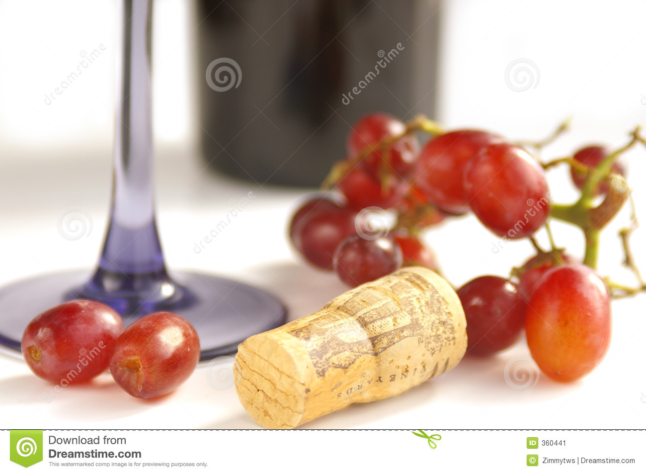 Grapes and cork with wine