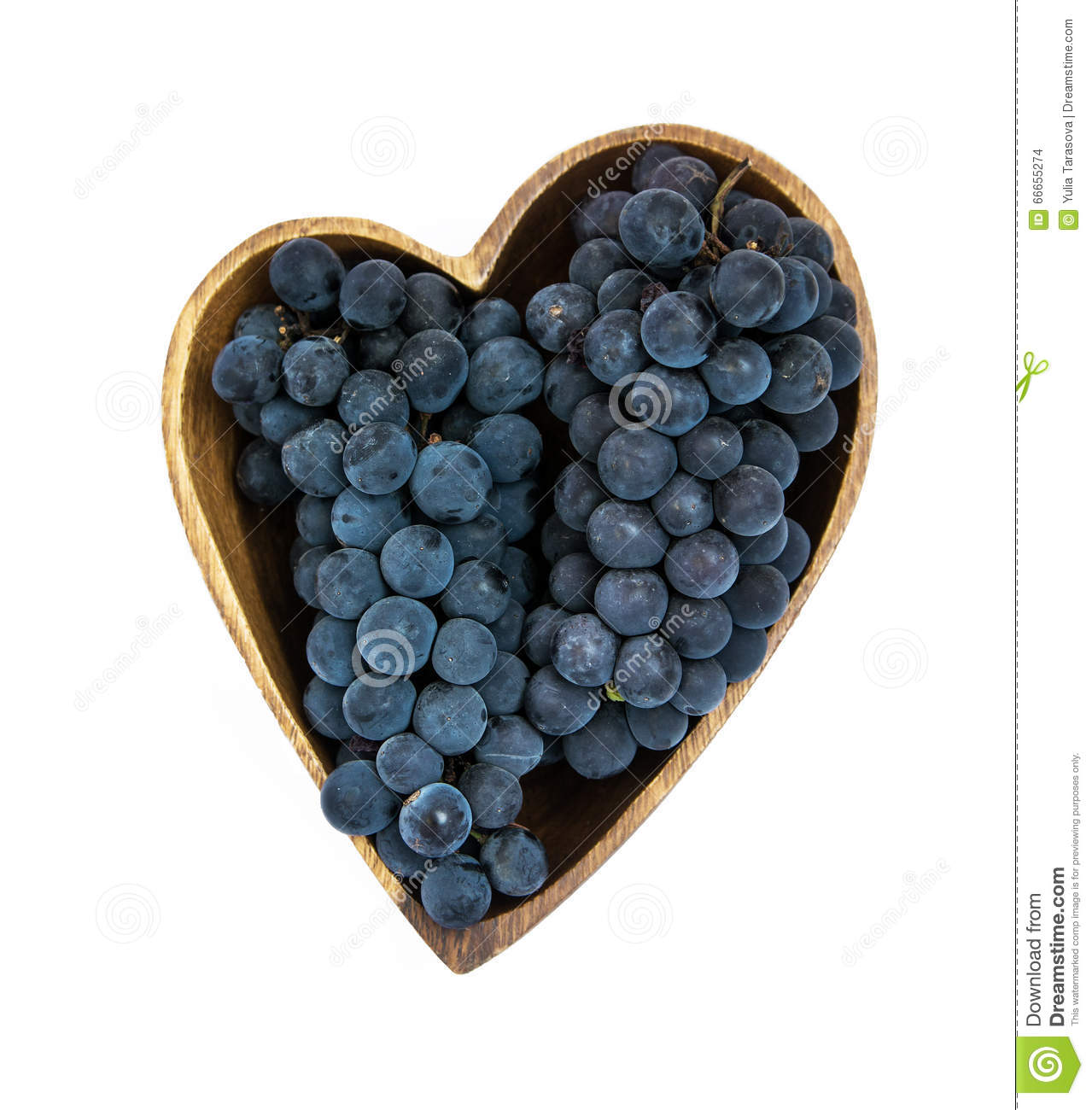 Grapes in a heart shape wooden plate