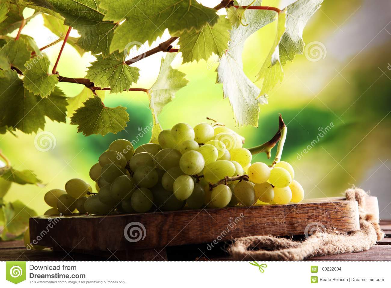 Grapes on wooden table and grape leaves . Healthy fresh fruit wine grapes
