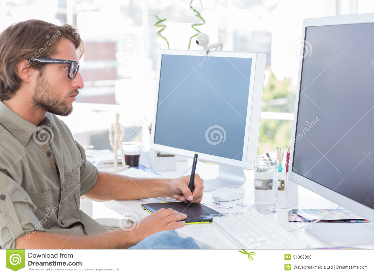 Graphic artist using graphics tablet royalty free stock for Job grafiker