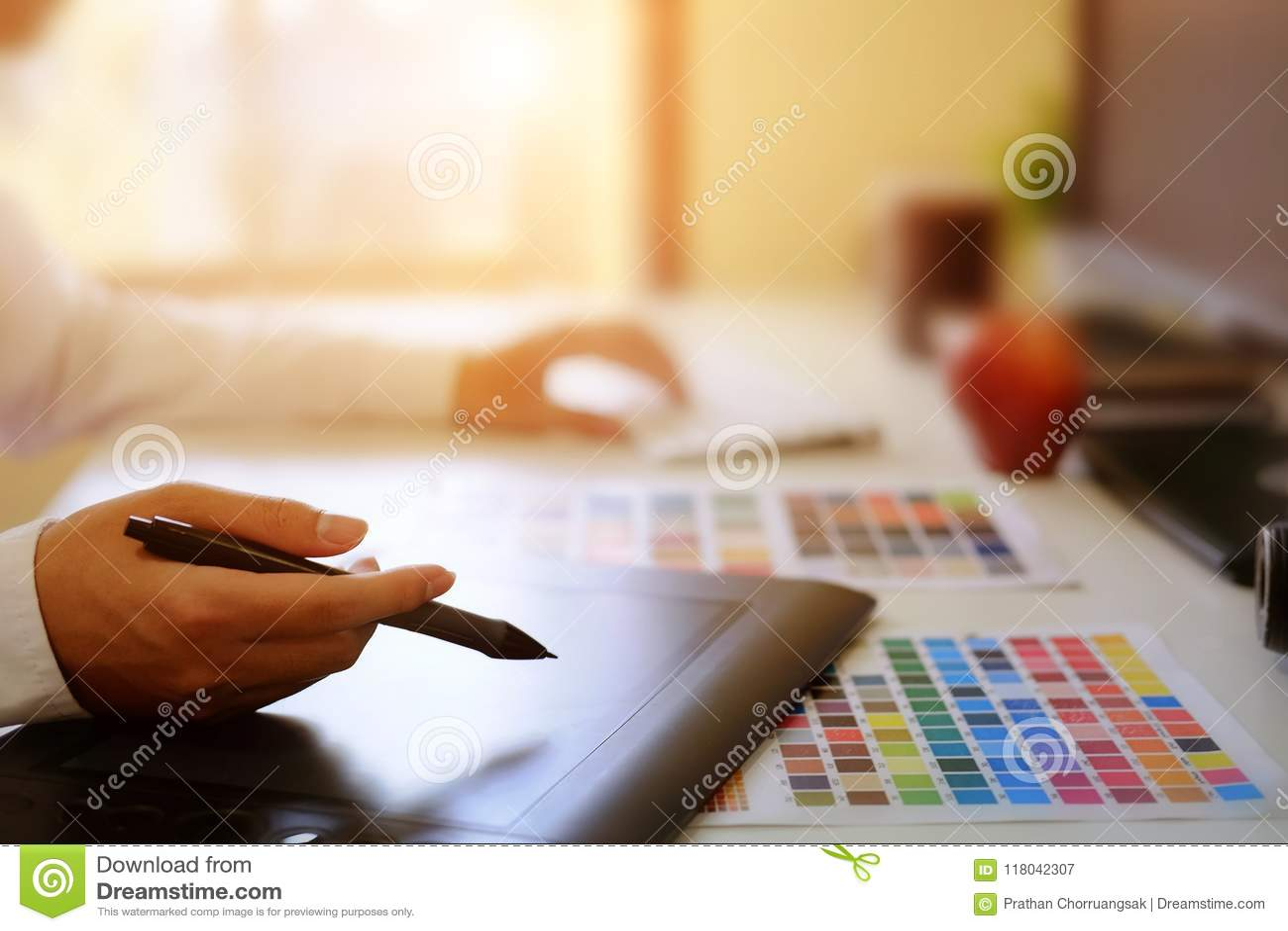 Graphic designer hands using digital tablet and computer.