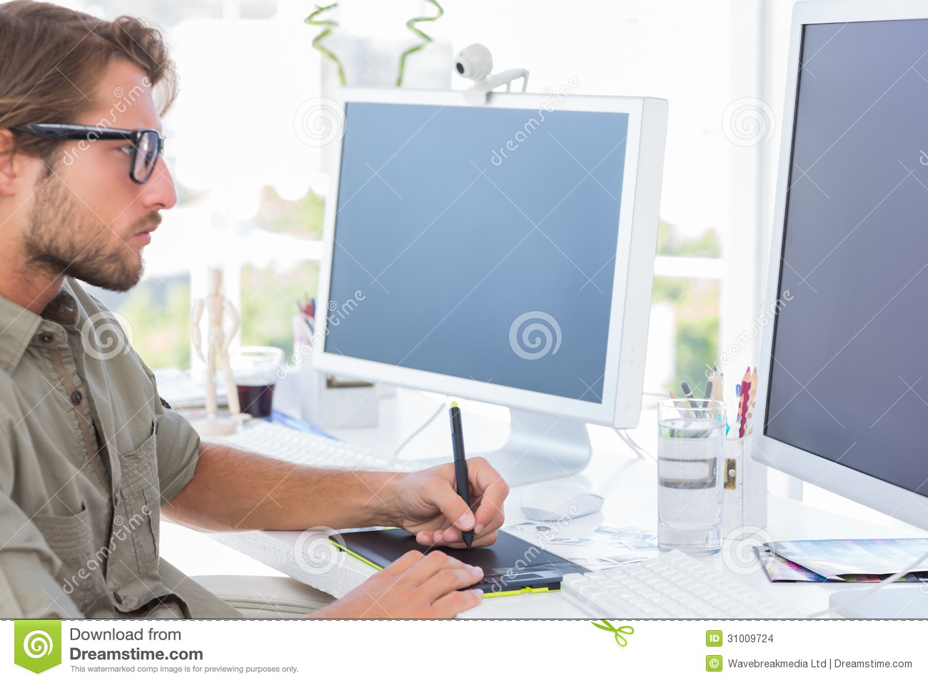 Graphic Designer Using Graphics Tablet Stock Images - Image: 31009724
