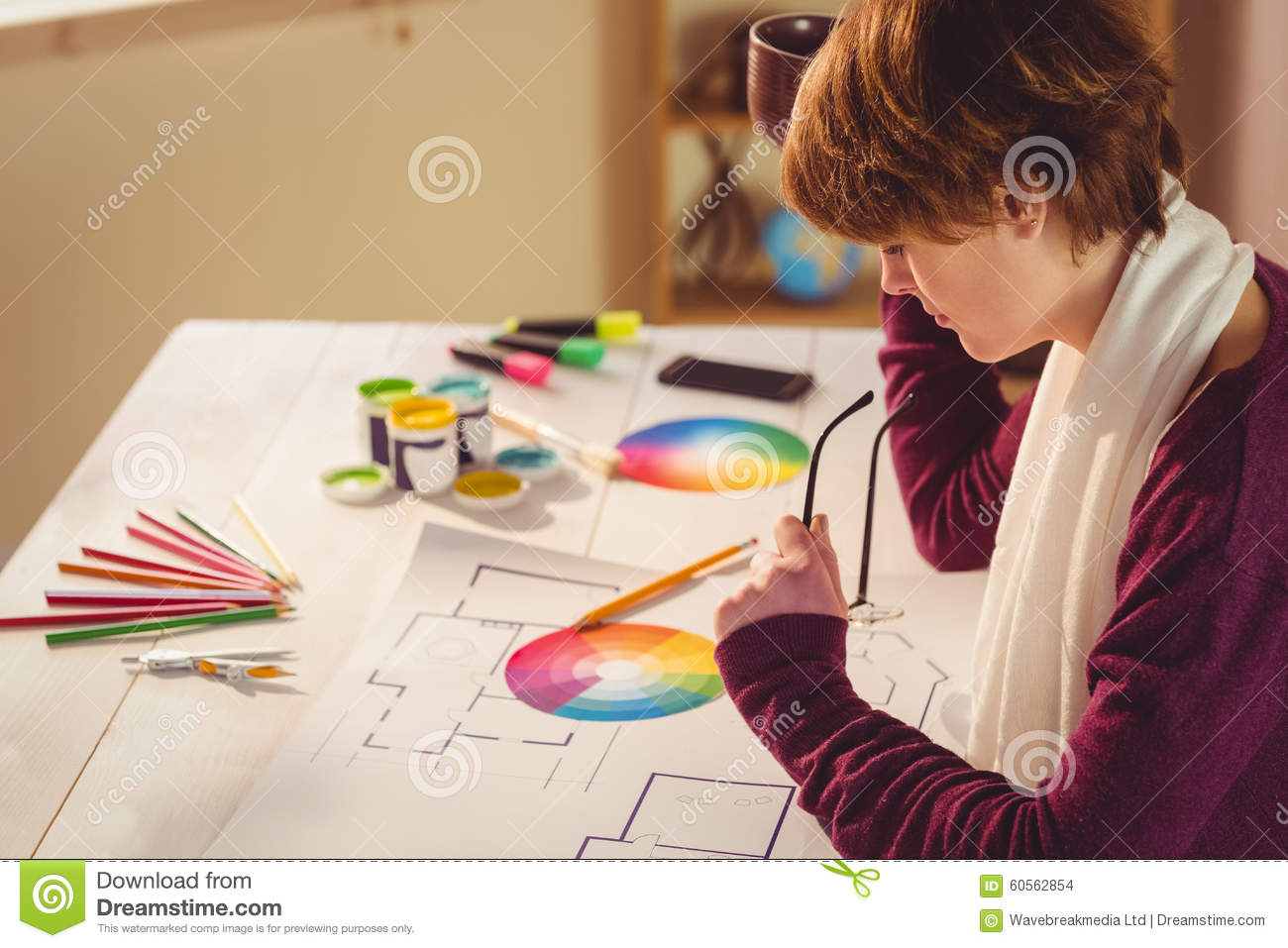 Graphic designer working at desk