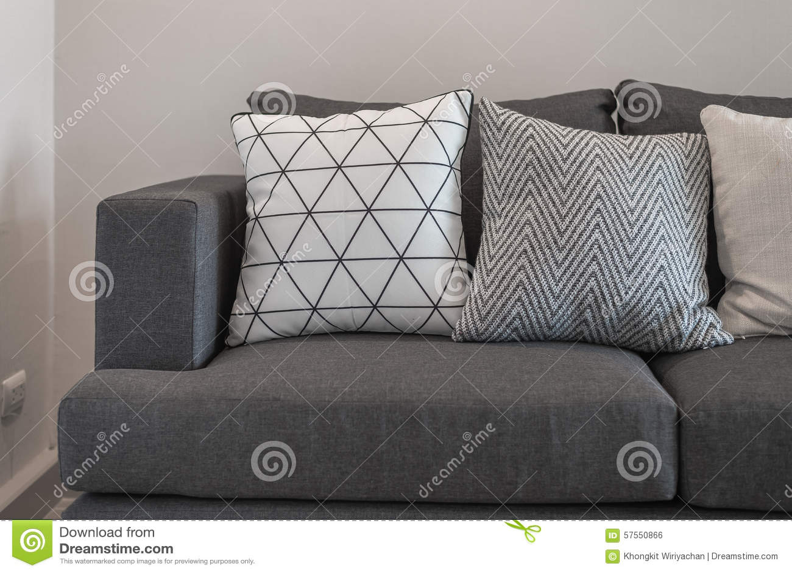 Graphic Pattern Pillows On Modern Grey Sofa