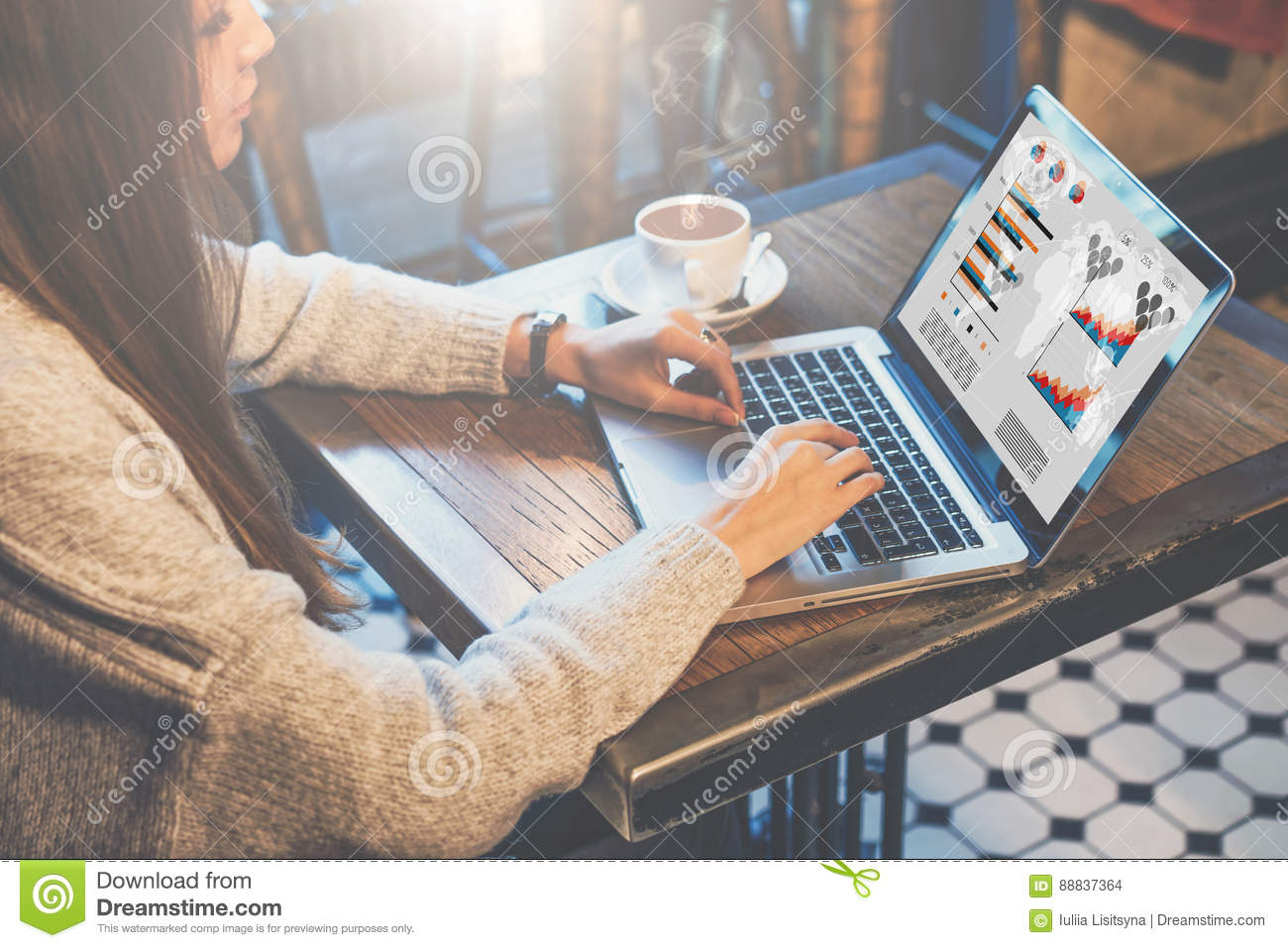 Graphics and diagrams on computer screen. Woman analyzing data. Student learning online. Freelancer working home