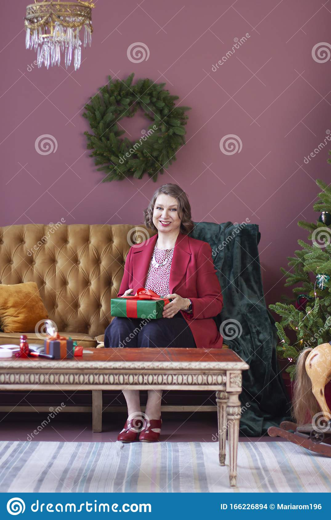 Grateful Smiling Mature Woman Is Holding Christmas Or New ...