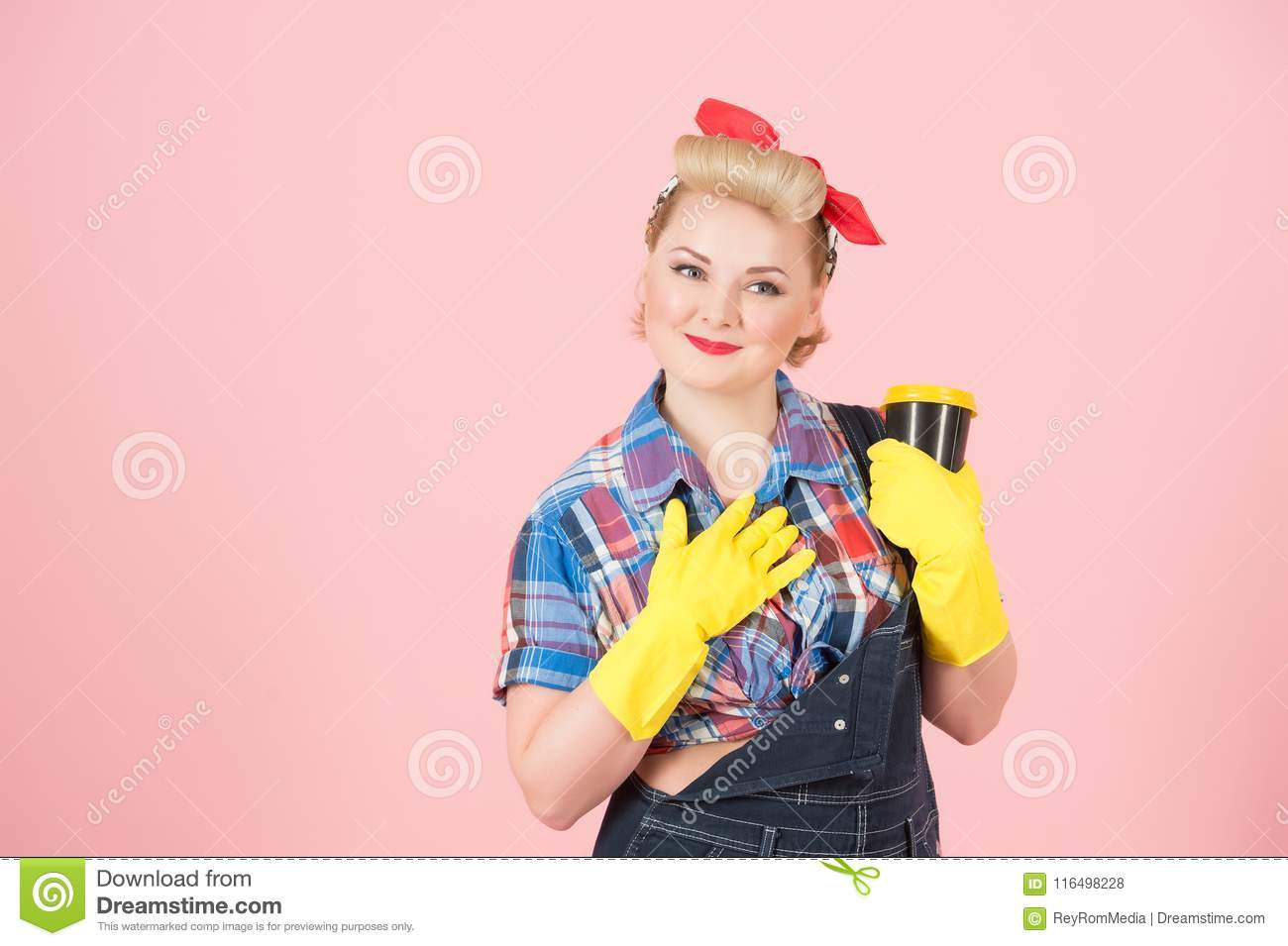 Gratefulness housewife holding craft cup. Portrait of thankfulness woman in latex gloves with cup of coffee in pin-up style.
