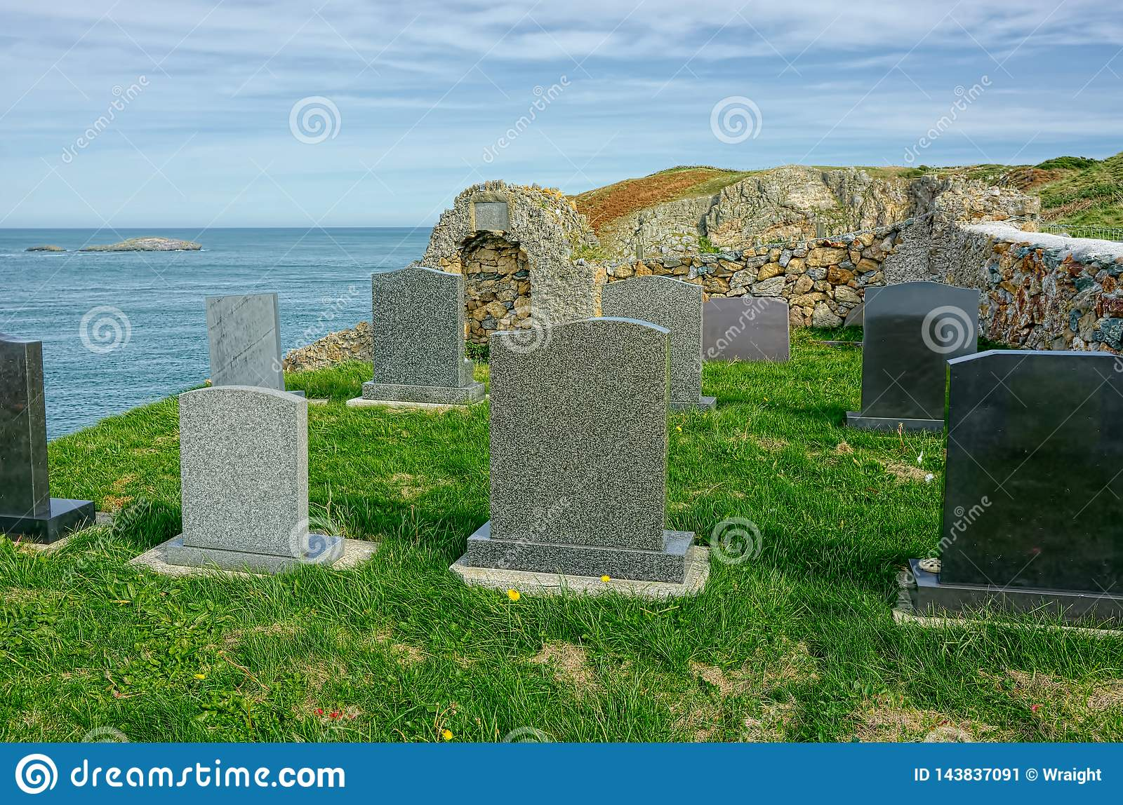 Graves on cliff edge. Final resting place with dramatic sea view.