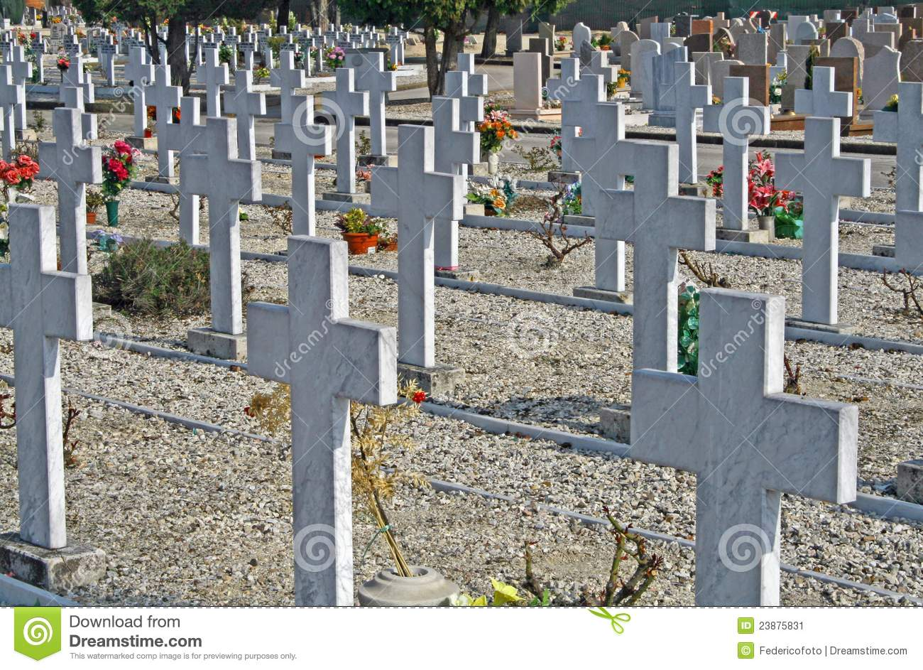 Graves headstones and crucifixes of a cemetery