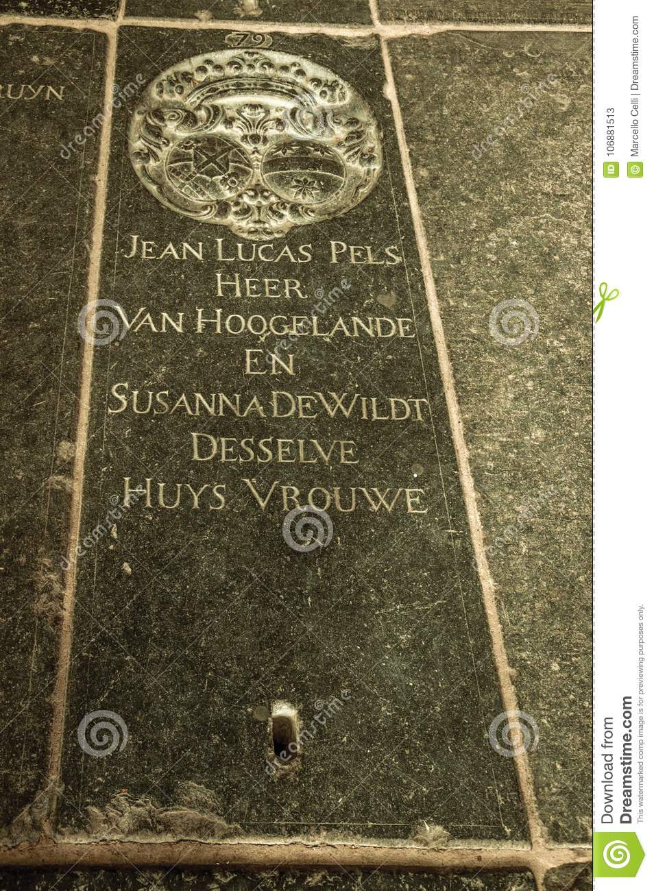 Gravestone With The Dead's Name And Coat Of Arms On The