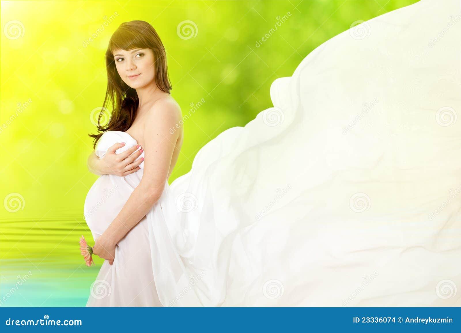 Gravid kvinna för tusenskönablommapink